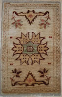 HANDKNOTTED MINI RUG